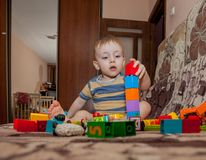Sweet little boy building tower from cubes at home Royalty Free Stock Photography