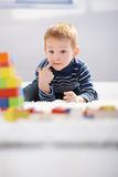 Sweet little boy lost in playing Royalty Free Stock Image