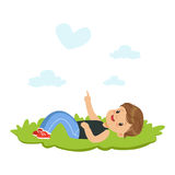 Sweet little boy lying on a grass and dreaming looking on the sky, kids imagination and fantasy, colorful character. Vector Illustration isolated on a white Royalty Free Stock Photography
