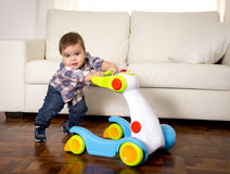 Free Sweet Little Boy Playing Alone With Baby Walker Taking His First Steps Excited And Playful Royalty Free Stock Photo - 50157385