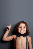 Sweet little boy pointing upwards. Portrait of sweet little boy pointing upwards Royalty Free Stock Photos