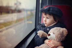 Sweet little boy, riding in a bus, daytime Stock Photos