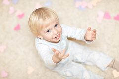 Sweet little boy sitting on the floor Royalty Free Stock Photo