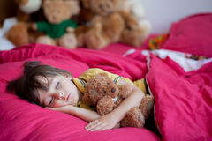 Sweet little boy, sleeping in the afternoon with his teddy bear Stock Photo