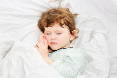 Sweet little boy sleeping  in bed. Stock Image