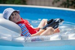 Sweet little boy, swimming in big swimming pool Stock Image