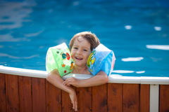 Sweet little boy, swimming in big swimming pool Royalty Free Stock Images