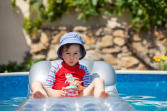 Sweet little boy, swimming in big swimming pool Stock Photography