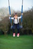 Sweet little boy, swinging in a park Stock Image