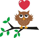 Sweet little brown owl with a red heart Royalty Free Stock Photo