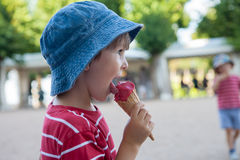 Sweet little child, boy, eating ice cream stock photo