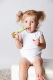 Sweet little child brushing her teeth alone Stock Image