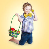 Sweet little child holding easter egg basket Stock Photos