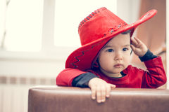 Sweet little cowgirl. With a red hat royalty free stock photos