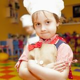 Sweet little cute child girl is ready learn to cook. Humorous ph. Oto Royalty Free Stock Images