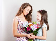 The portrait of happy mom and daughter royalty free stock photo