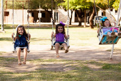 Sweet little friends having fun in a park Royalty Free Stock Image