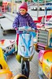 Sweet little girl in amusement park Stock Photo