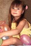 Sweet Little Girl with Balloons stock image
