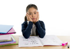 Sweet little girl bored under stress with a tired face expression Stock Photo