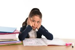 Sweet little girl bored under stress with a tired face expression Royalty Free Stock Photo