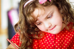 Sweet little girl coloring Stock Photos