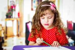 Sweet little girl coloring Royalty Free Stock Images