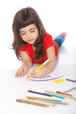 Sweet little girl doodling. Image of girl doodling, on white background Stock Photo