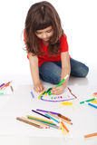 Sweet little girl doodling. Image of girl doodling, on white background Stock Photos