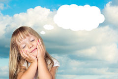 Sweet little girl. Dreaming of something Royalty Free Stock Photo