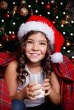 Sweet little girl drinking a glass of milk Stock Photo