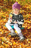 Sweet little girl  in fall time Stock Image