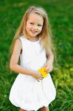 Sweet little girl with flower in a park Royalty Free Stock Photography