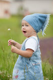 Sweet little girl with flower Stock Images