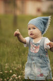 Cute little girl with flower Stock Photography