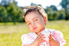 Sweet little girl on the grass Stock Images