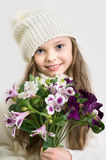 Sweet little  girl with hat and flowers bunch in hands Royalty Free Stock Image