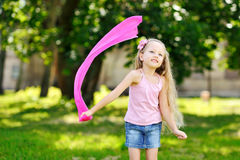 Sweet little girl having fun in a park Stock Images