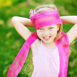 Sweet little girl having fun in a park Royalty Free Stock Image