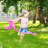 Sweet little girl having fun in a park Stock Photography