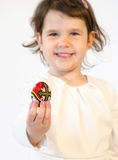 Sweet little girl hold an easter egg painted isolated on white Stock Photography
