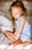 Sweet little girl in light blue pajama Stock Photography