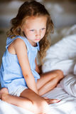 Sweet little girl in light blue pajama Royalty Free Stock Photo