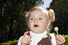 Sweet little girl with lollipop Royalty Free Stock Photo