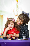 Sweet little girl making crafts with her mother Royalty Free Stock Photos