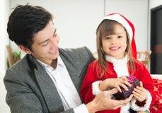 Sweet little girl opening Christmas present Stock Image