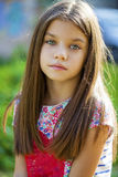Sweet little girl outdoors Stock Photos