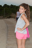Sweet little girl outdoors with curly hair in the wind Royalty Free Stock Photography