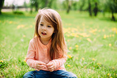 Sweet little girl outdoors with long hair. Royalty Free Stock Photo