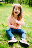 Sweet little girl outdoors with long hair. Royalty Free Stock Photography